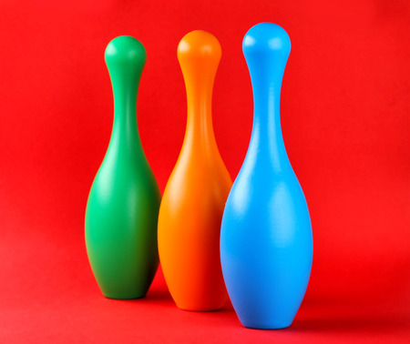 Bright bowling pins on color background