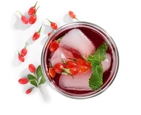 Glass with goji juice on white background Reklamní fotografie