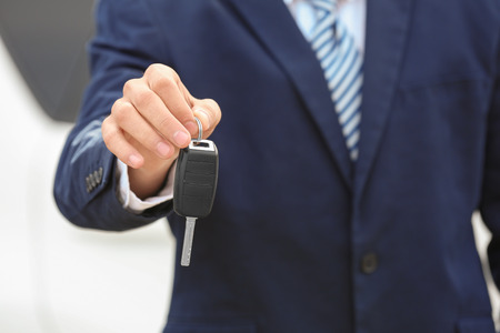 Salesman with car key, close up Stockfoto