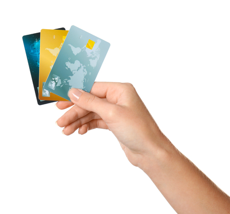 Woman's hand holding credit cards on white background Banque d'images