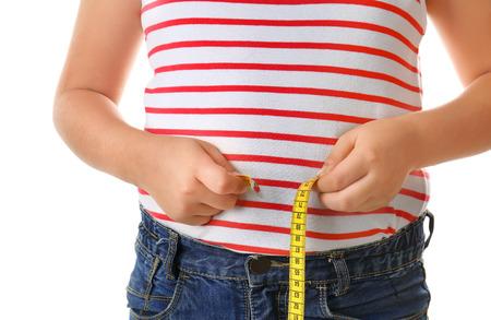 Overweight boy measuring waist on white background, closeup Stock Photo
