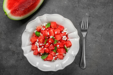 Bowl with delicious watermelon salad on table
