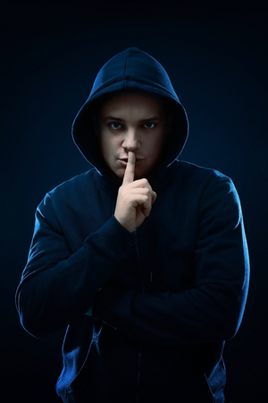Professional hacker on dark background Stockfoto