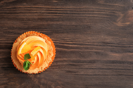 Tasty cake on wooden background