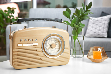 Retro radio on table Reklamní fotografie