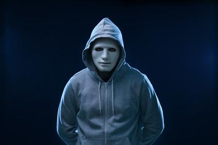 Hacker in mask on dark background Stock Photo - 113333251