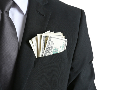 Businessman with dollar bills in pocket on white background, closeup