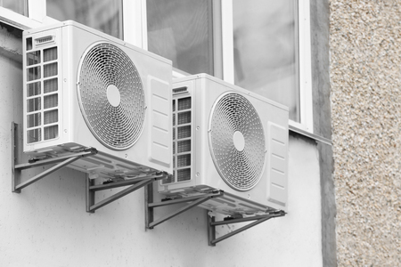 Air conditioners on wall of building, outdoors Stock Photo