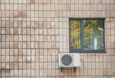 Air conditioner on wall of building outdoors Zdjęcie Seryjne