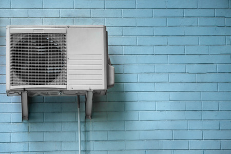 Air conditioner on wall of building outdoors Фото со стока