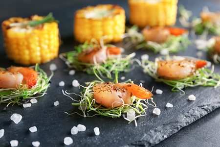 Slate plate with delicious grilled shrimp on table Stock Photo
