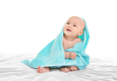 Cute little boy with towel on white background Stock Photo