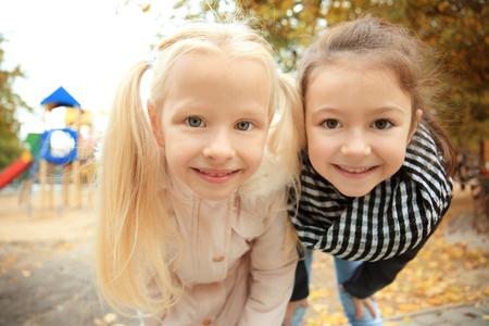Cute little girls in outwear outdoors