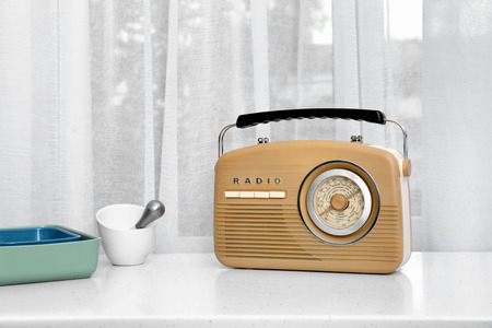 Modern radio on table in kitchen