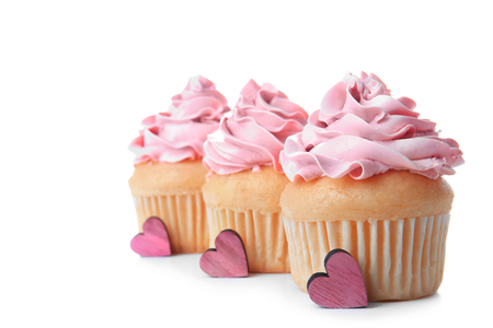 Delicious vanilla cupcakes on white background