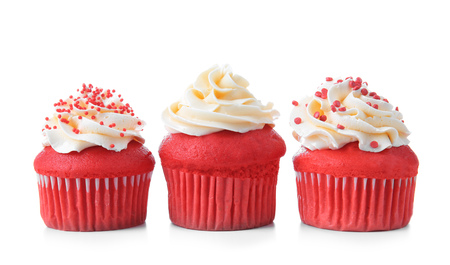 Delicious red velvet cupcakes on white background