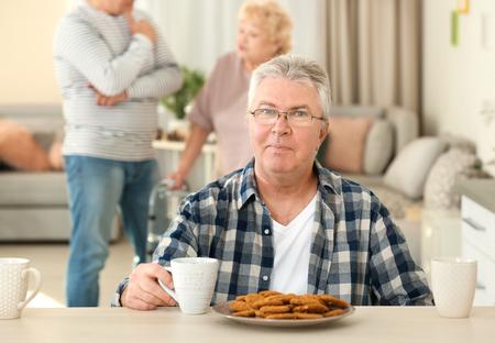 Senior man having breakfast at care home