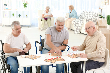Senior people playing lotto at care home