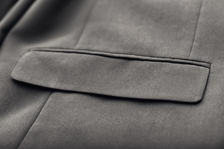 Tasca su elegante abito maschile, primo piano Archivio Fotografico
