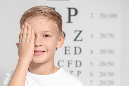 Cute little boy in ophthalmologist's office Archivio Fotografico