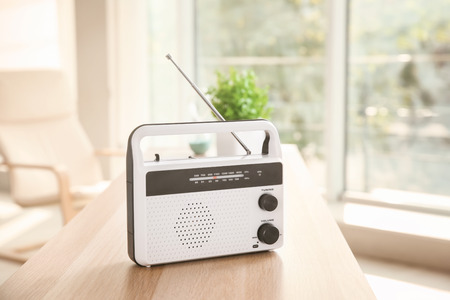 Retro style radio on table indoors