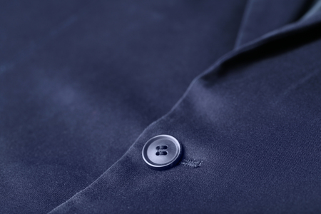 Button on elegant male suit, closeup Archivio Fotografico