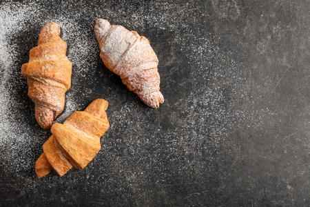 Tasty croissants on table
