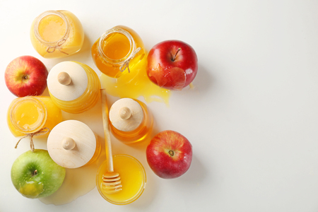 Composition with aromatic honey and fruit on white background Stock fotó