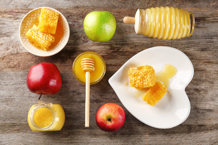 Composition with honey and fruit on wooden background Stock fotó