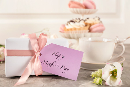 Gift for Mothers day with card and flower on table