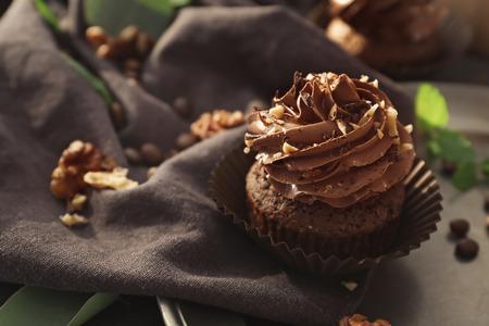 Tasty chocolate cupcake on table Standard-Bild - 111786997