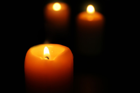 Burning candles on dark background, closeup Stock Photo