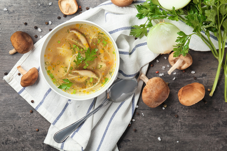 Bowl of delicious shiitake mushroom soup on table