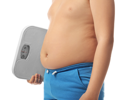 Overweight boy with scales on white background, closeup