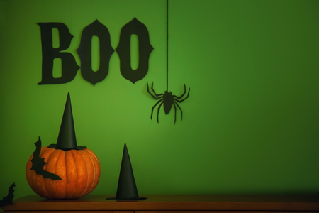 Creative composition for Halloween party on color background