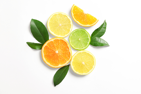 Composition with ripe lemon, orange and lime on white background