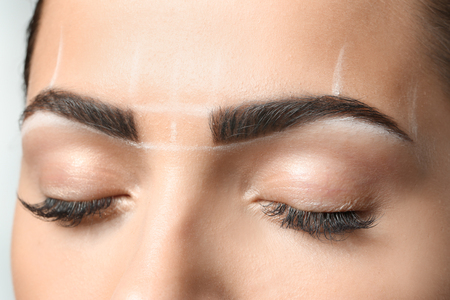 Young woman before procedure of eyebrows permanent makeup, closeup Stock Photo