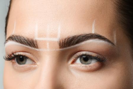 Young woman before procedure of eyebrows permanent makeup, closeup Archivio Fotografico