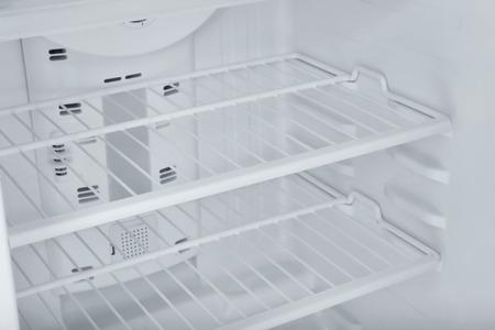 Empty refrigerator shelves, closeup