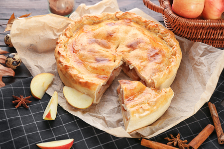 Freshly baked apple pie on table