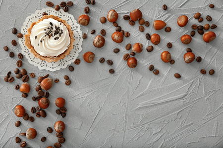 Composition with tasty tartlet on textured background, top view
