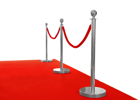 Red carpet with rope barrier, isolated on white