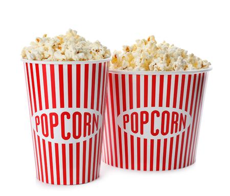 Cups with popcorn on white background 版權商用圖片
