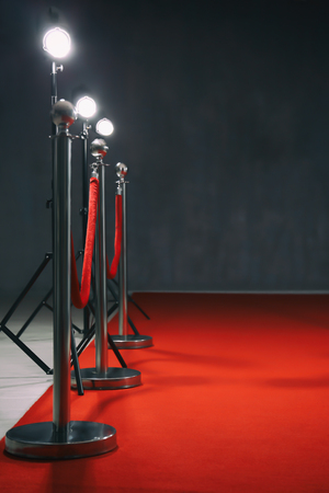 Red carpet with rope barrier indoors