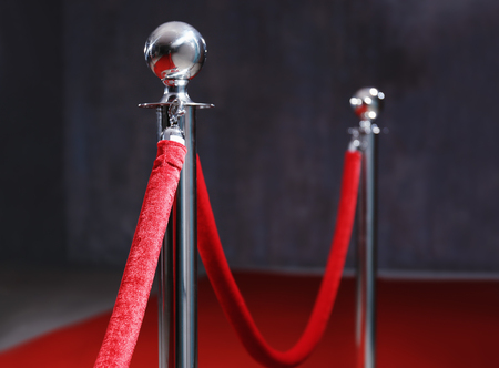 Rope barrier and red carpet indoors Banco de Imagens