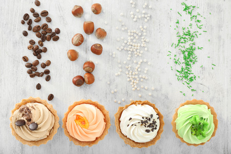 Assortment of tasty tartlets on wooden background, flat lay Stock fotó