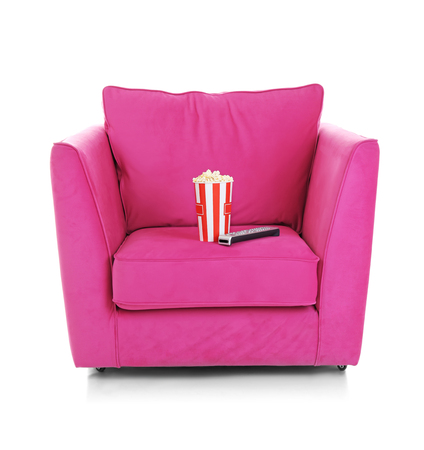 Cinema armchair with popcorn and remote control, isolated on white background