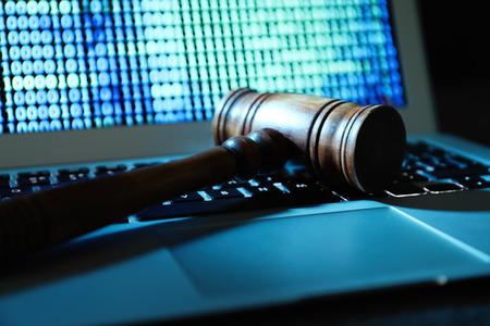 Judge gavel on laptop keyboard, closeup