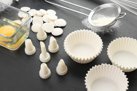 Kitchen utensils and ingredients for pastries on slate plate Stock Photo