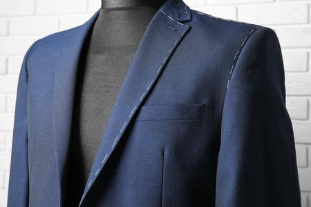 Semi-ready suit on mannequin indoors, closeup Stock Photo